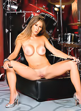 Passionate teen drummer girl Felony strips her mini skirt and shows her hot pussy.
