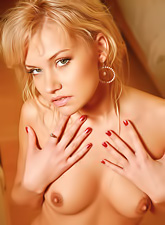 Frisky Elisha Cuthbert shows her petite body and her clean shaved pussy also.