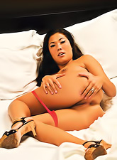 Beautiful and seductive brunette gal London Keyes strips her pink lingerie on the bed.