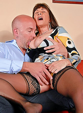 Alexandra Silk wears sexy black stockings and gets screwed from behind wildly.