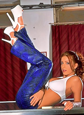 Busty redhead babe Ashley Robbins strips her blue pants and teases in blue pants.