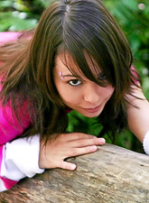 Ariel Rebel gets undressed and even performs an exotic dance on a log in a wood.