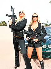 Nikki Benz and Puma Swede use their guns and tits to make a lad serve their holes.