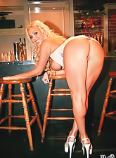 Busty blonde hottie Mary Carey strips her clothes and shows her fuckable tight ass.