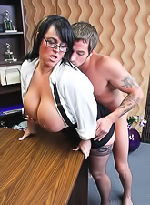 Hot momma brunette Indianna Jaymes with huge jugs having a doggy style sex at office.