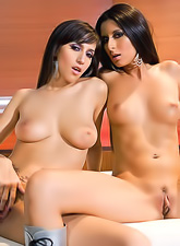 April O'Neil and Nikki Daniels getting naked and licking each others wet pussy.