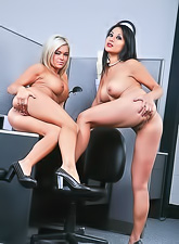 Crista Moore and Gianna Lynn getting naked in their office and sharing a big cock.