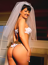 Slutty brunette bride Carmen Hart strips her bridal lingerie and shows her huge ass.