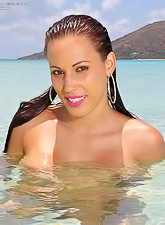 Layla Rivera takes her little pink bikini off on the beach and shows us her big rack.