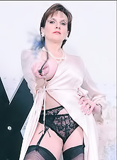 Lady Sonia takes all of her clothes before the camera and teases us in stockings.