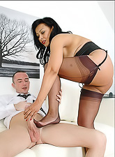 Lady Sonia wears kinky and classy lingerie as she gives stud a good nylon footjob.