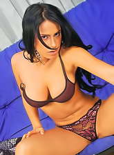 Aroused Selena Spice with sexy body and big bazookas wearing sexy lingerie posing.