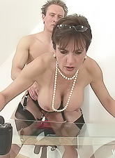 Lady Sonia takes all of her clothes before the camera and strokes off a big hard cock.