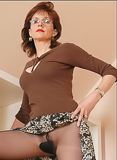 Lady Sonia removes her classy dress and teases us in expensive black stockings.