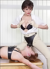 Lady Sonia equips her big strapon cock and lets dyke bitch swallows it wildly.
