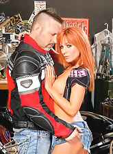 Hot redhead vixen Kirsten Price moans hard as she rides on top of biker's cock.