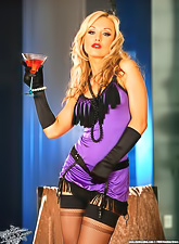Hot Kayden Kross poses in a sexy outfit which she then takes off while drinking wine.