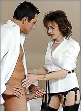 Lady Sonia wears classy outfit as she jerks off her lover's big stiff meat rod.