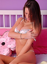 Cute teen angel from Kates Playground strips and teses in little white thongs.