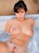Petite April O'Neil invites everybody to spend a day with her in the hot tub.