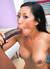 Seductive Asian babe Tia Ling strips her clothes and gets nailed by huge black cock.