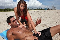 Slutty redhead hottie Skyla Paige moans hard as she gets pumped on the beach.