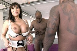 Ava Devine strips all of her lingerie and then fucks with two hung black studs.