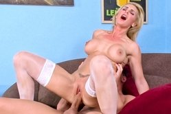 Tanya Tate takes her sexy lingerie off on the sofa and fucks in white stockings.