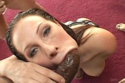 Gianna Michaels kneels before her hung lover and slurps on his big hard meat rod