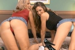 Kayla Paige and Kayla Synz take their clothes off together and share a big cock