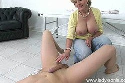 Lady Sonia takes her slutty blue jeans off and sucks her lover's big stiff cock