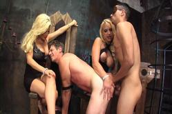 Nasty femdom bimbos get two straight dudes in their dungeon and turn them gay with anal