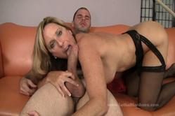 Hot blonde gropes her big hotters during a blowjob and gets screwed on her comfy couch