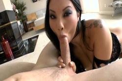 Asa Akira kneels submissively before her hung lover and sucks his hard fat cock