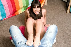 Ava Devine takes her clothes off on the floor and gives her handsome lover a footjob.
