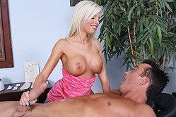 Britney Amber strips her cute outfit and gives her lover an amazing handjob